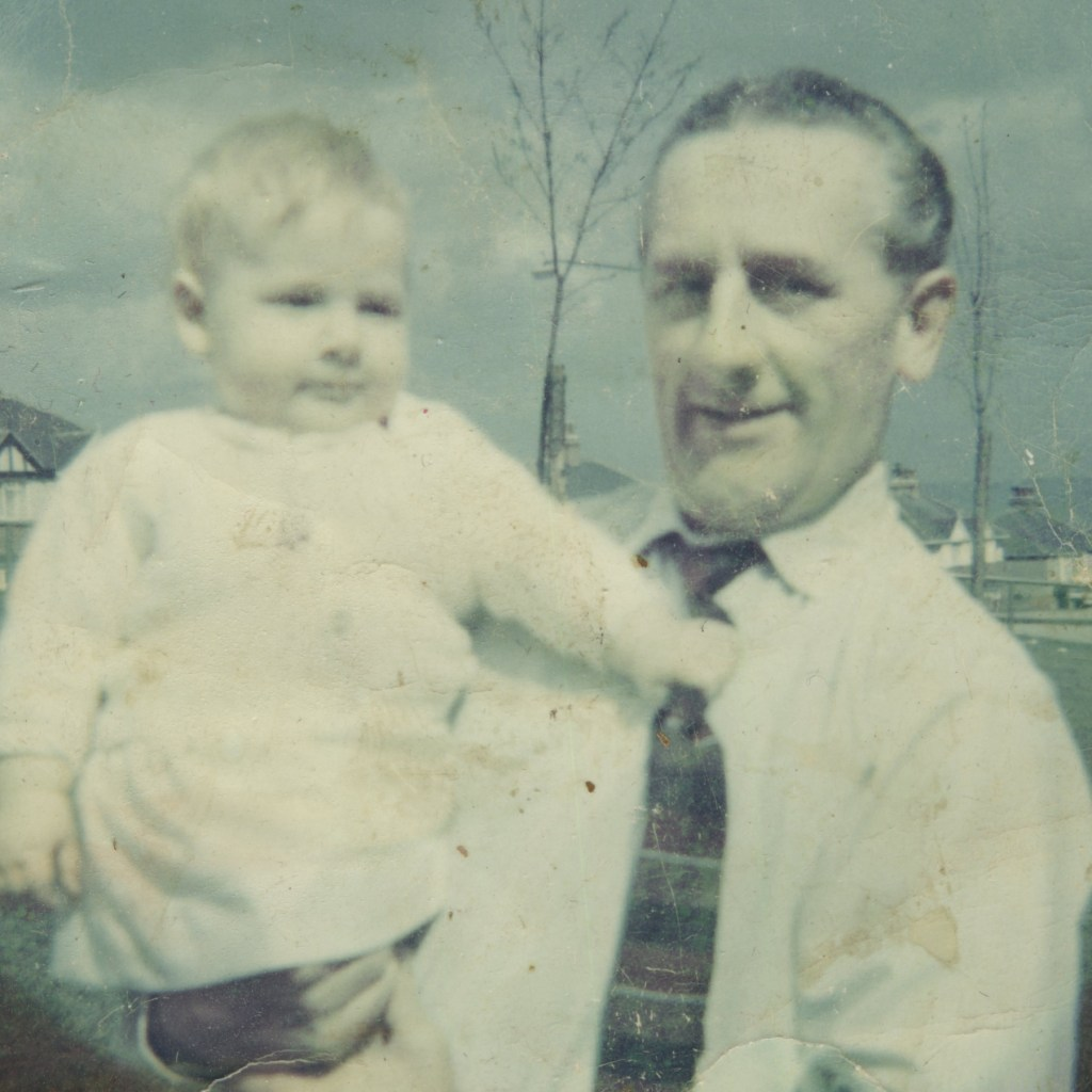 Photo of a man with a baby which has become discoloured fading.