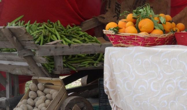 Potatoes, fresh beans and oranges