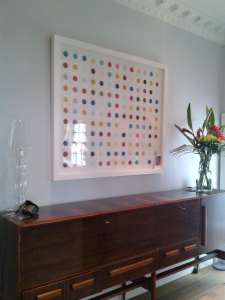 Damien Hirst spot painting hung in a foyer of a house in Hove