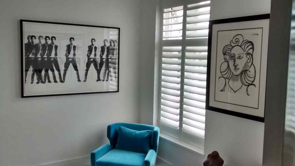 'Hang 'em up!' Large monochrome prints in a living room in Eastbourne.