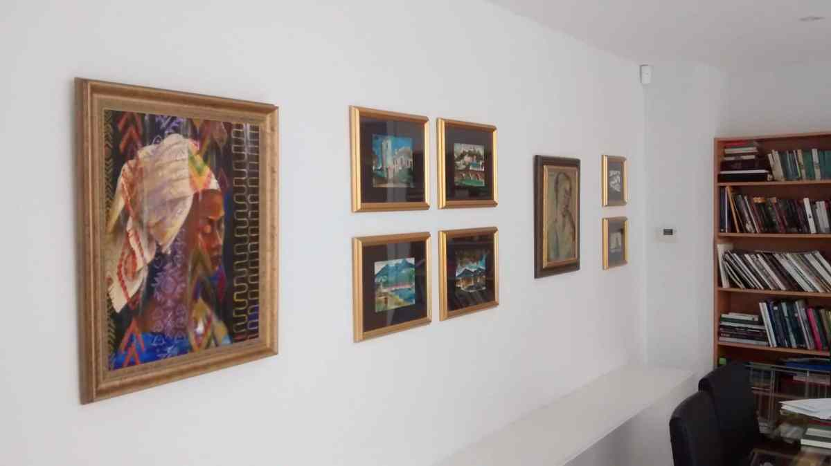 Gallery wall of eight pictures, the length of which, allowed for plenty of breathing space between the singular artworks and the smaller groupings.