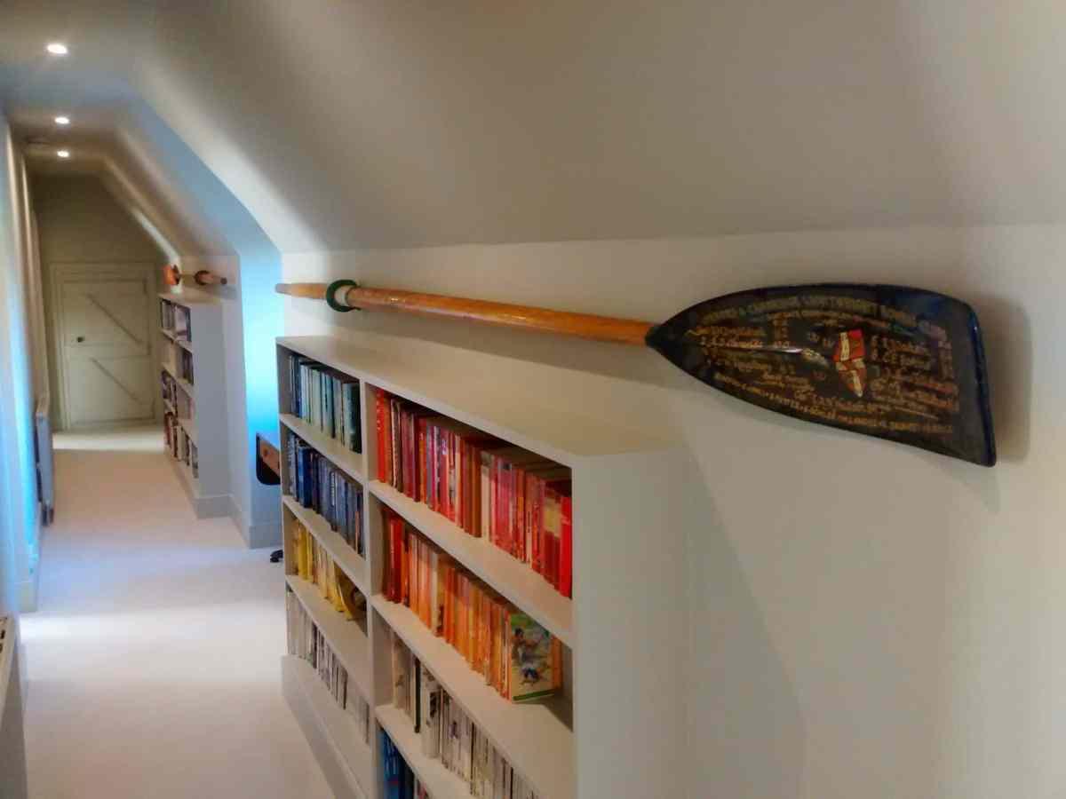 Keeping the hallway ship shape. A commerative rowing oar hung in a loft conversion near Grayshott, Hampshire.