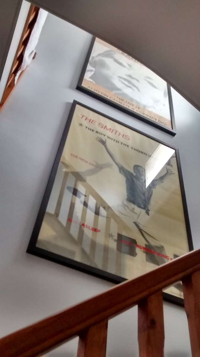 The Smiths band posters hung in a stairwell in Burgess Hill.