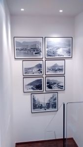 A picture wall of archival photos of Cape Town. A two metres high arrangement hung in a stairwell in Hampstead.