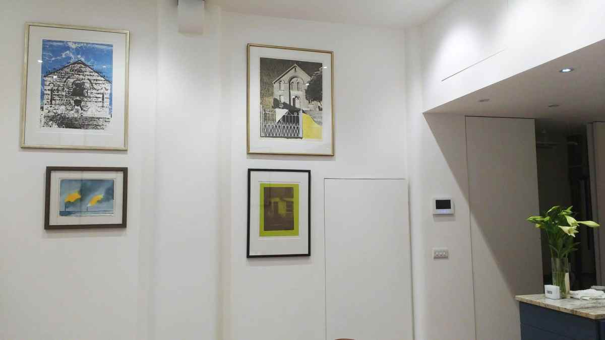 four pictures hung in high-ceilinged dining area in Kemp Town, Brighton