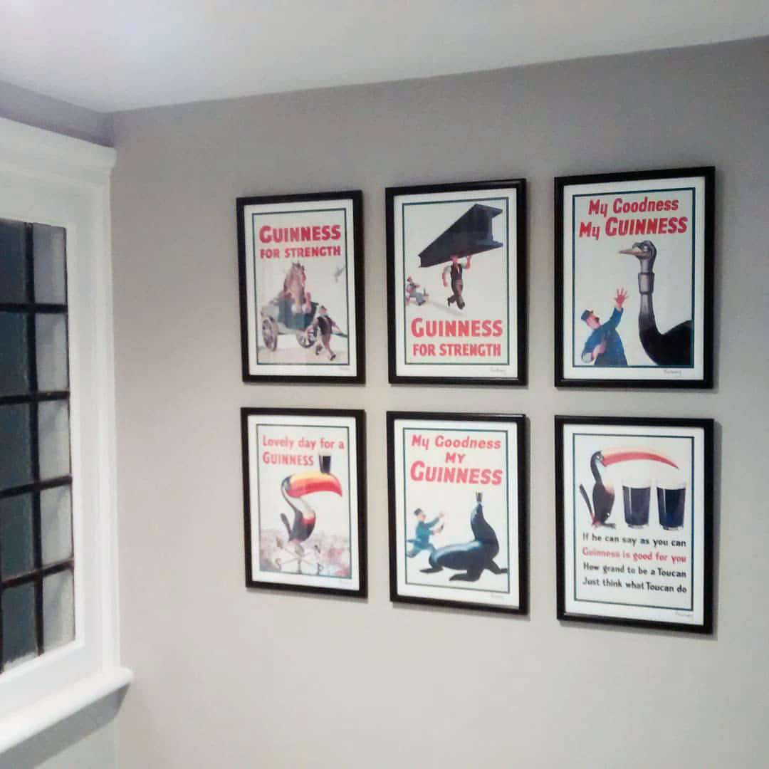 six pictures of vintage guinness posters hung in a grid formation.