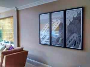 A dark framed photographic triptych hung in a living room in Goudhurst, Kent.