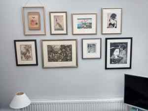 Collage wall of Japanese prints hung in Lewisham.
