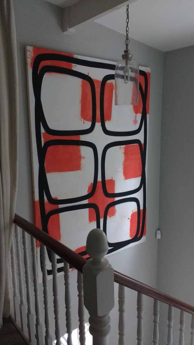A large abstract canvas hung in a stairwell in Richomnd.