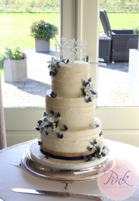 buttercream-wedding-cake-navy-butterflies-peak-edge
