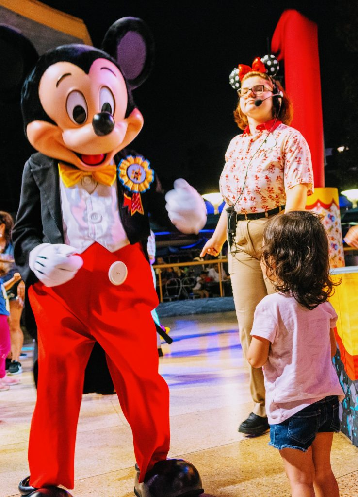 Having a great time dancing with mickey at disneyland.