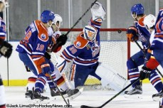 Kenny Agostiono's (15) shot hits the goal post as Condor Goalie Ben Scrivens looks for the rebound