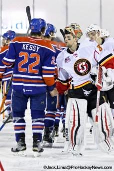 Post game handshake between Kale Kessy (22) and Joni Ortio