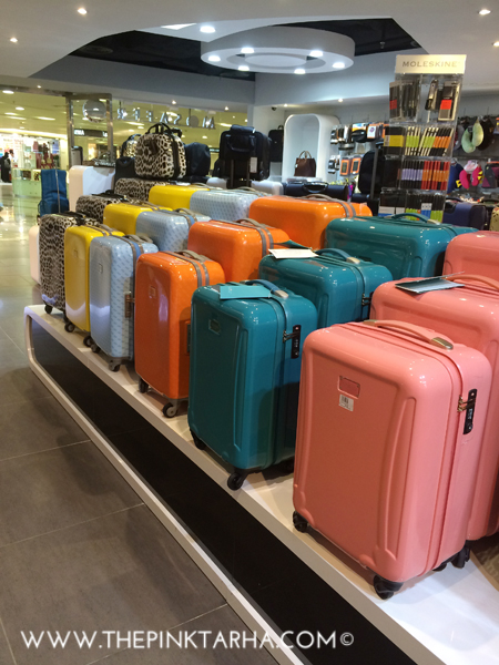 Of course my eyes would initially be drawn to the candy-colored suitcases.