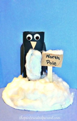 toilet paper tube penguin at the North Pole. Recyclable cardboard roll arts & crafts for kids for winter and Christmas