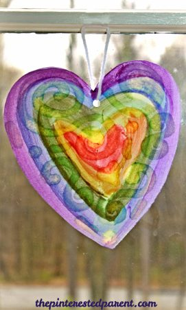 Oil resist watercolor suncatcher paintings - this is an easy arts & craft project for kids or adults. The oil produces a lovely effect after painted