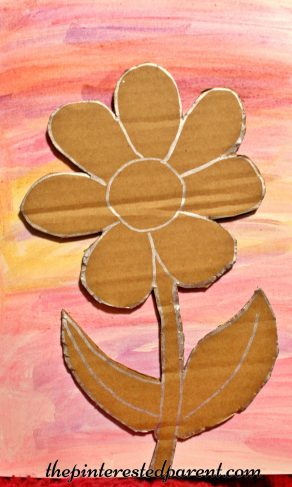 Glittery cardboard flower on watercolor paints - a pretty spring or summer arts & crafts project for kids
