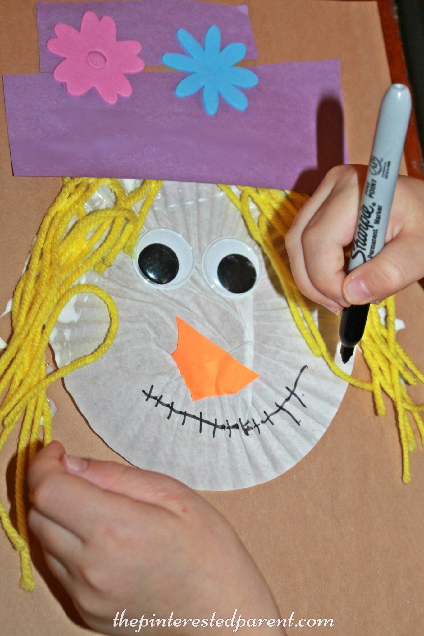 fall craft ideas cupcake liner scarecrow the pinterested parent 1978