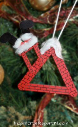 Popsicle Stick Roof Top Ornament with Santa stuck in the chimney - Christmas arts and crafts. Crafts stick projects for kids