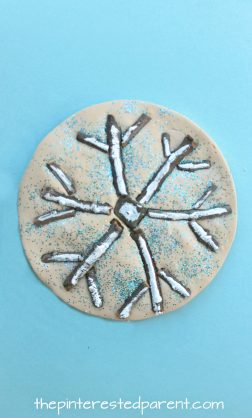 Sticks and stones snowflake winter nature crafts - use clay, salt dough or play dough to set these pretty seasonal arts and crafts projects for kids, rock snowman, twig snowflake & Christmas tree