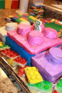 Lego cake and Lego sugar cookies for a Lego themed birthday party for kids. Check out more food, decorations and activities for a party.