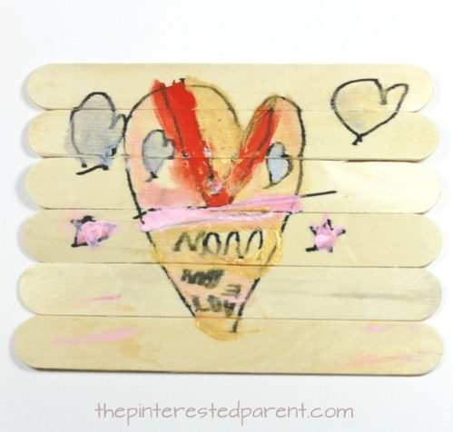 Popsicle stick Valentine's heart puzzle. Make a sweet message for mom, dad or grandma and grandpa. Arts & crafts for kids and preschoolers. Cute gift idea.