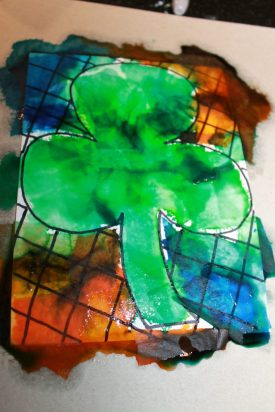 Bleeding tissue paper painted shamrocks for St. Patrick's Day. Easy arts and crafts art ideas for preschoolers and kids.
