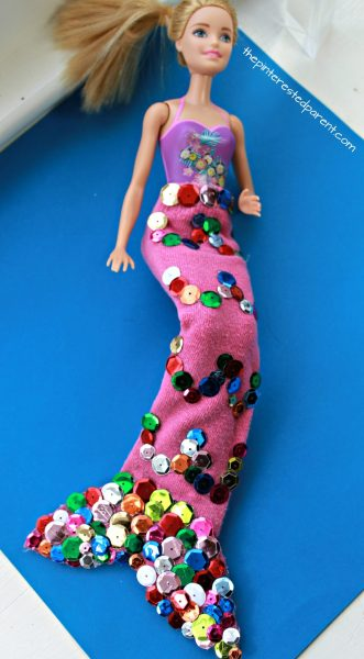 Use an old tube sock and some sequins to make this mermaid tail for your Barbie. Arts and crafts for your kids