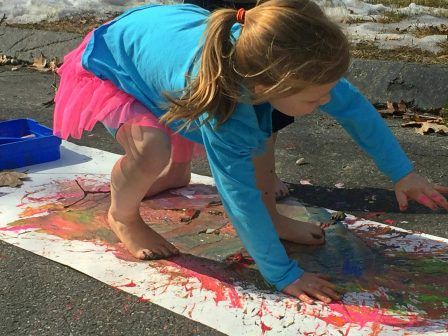 Messy paint play for the kids. Paint with hands and feet. Messy process art & play