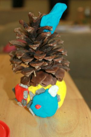Pine cone and salt dough fairy houses. Magical nature arts and crafts for kids