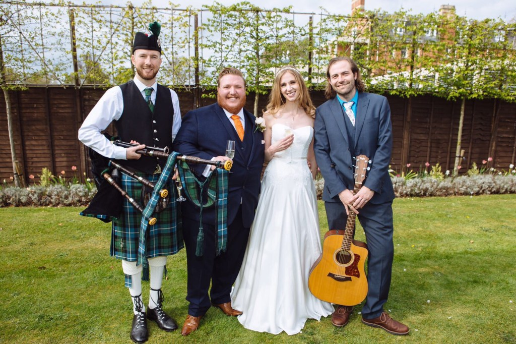 Image of Matthew McRae with the newly married couple in Worcestershire