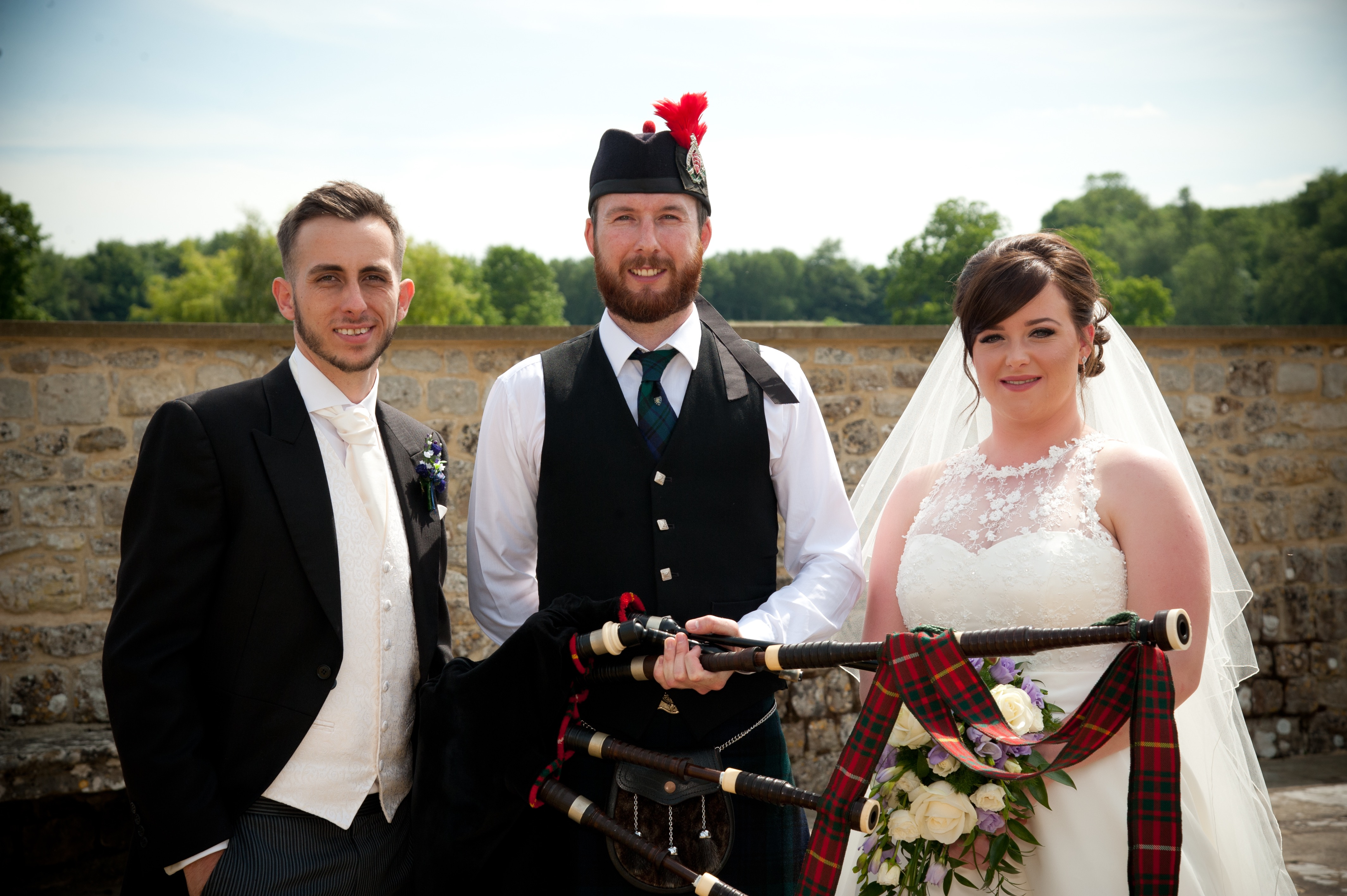 Image of Matthew McRae with the newly married couple in Leeds Castle, Kent