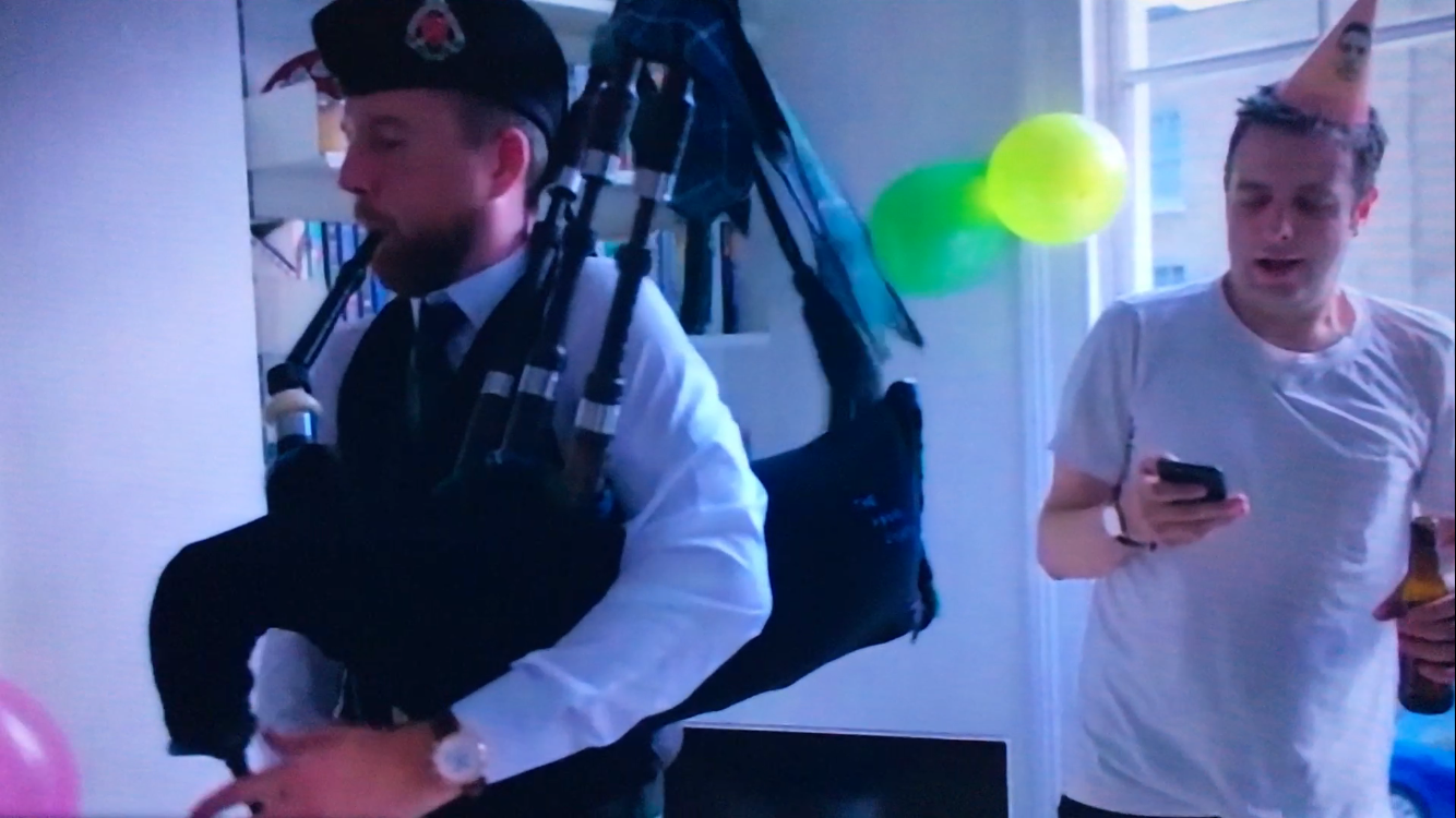 Image of Matthew McRae bagpiping at Thomas Craine's surprise party in London for the hit TV show 'The Last Leg'