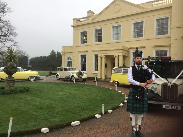 Image of Matthew McRae bagpiping at the Lawn wedding venue in Essex