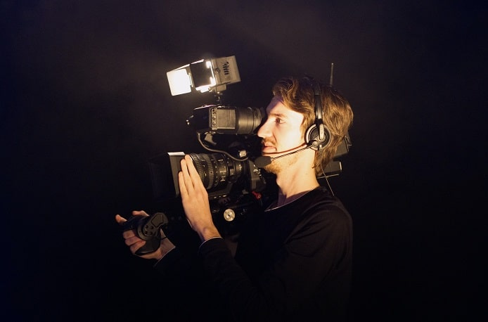 Man holding a camera with flash on
