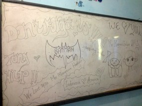 The right half of the white board decorated for me by one of my classes