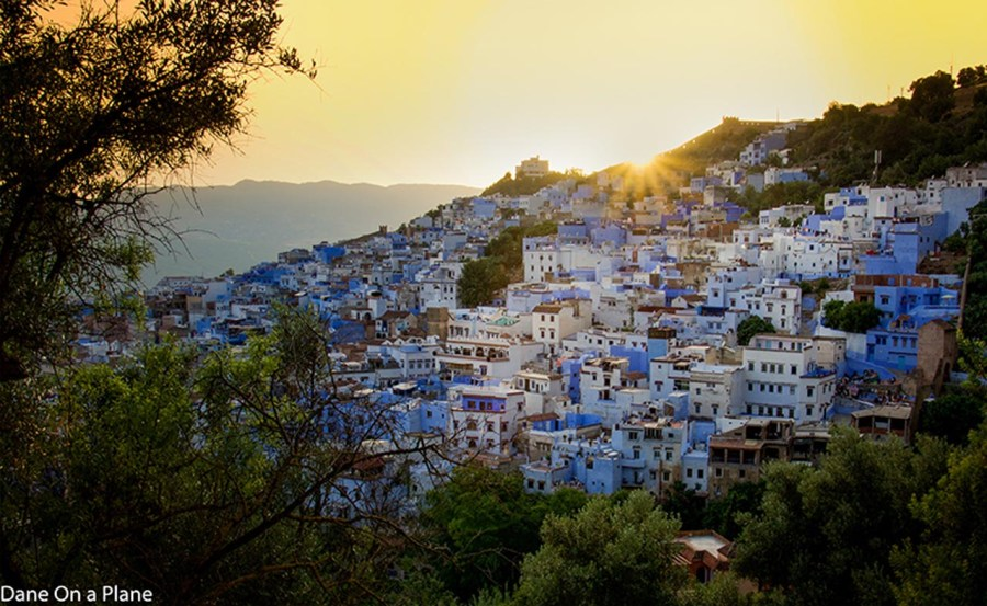 visit morocco town on hill at sunset