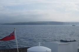 The ferry powers from Thurso toward Stromness, Orkney.