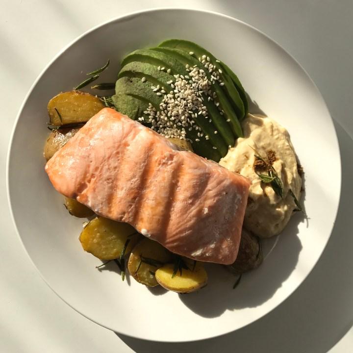 Salmon with Thyme Roasted Potatos, Hummus and Avocado