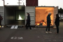 The south end of The Performance Arcade, with 'Boxer' by Jacqui Wilson and 'Walkign Through Walls' by Didier Morelli