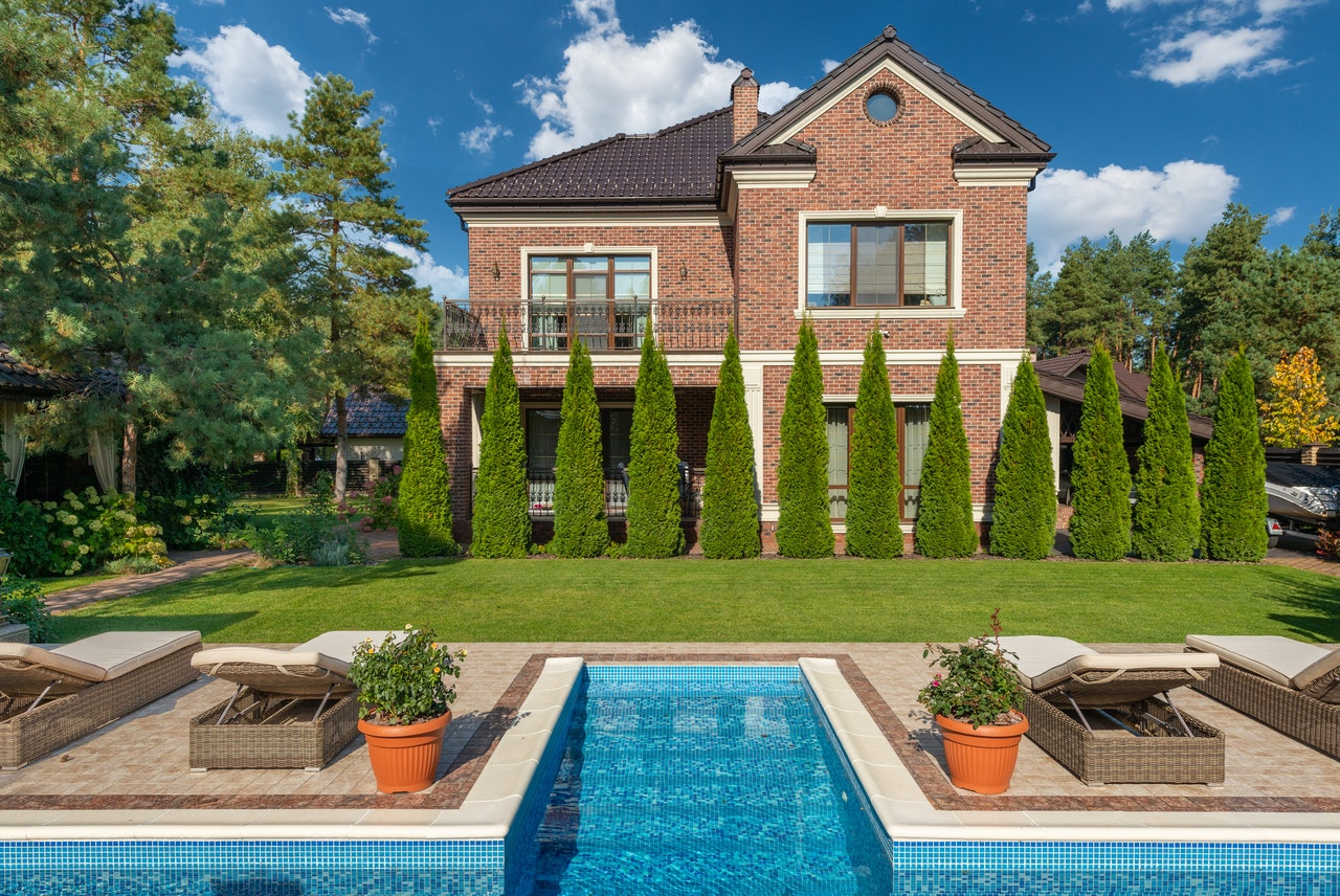 Exterior of a beautiful residential mansion with a pool