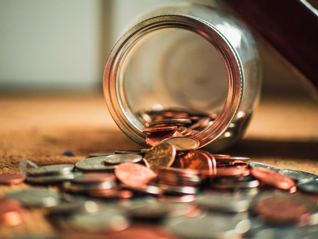 JAR AND SPILLED COINS.