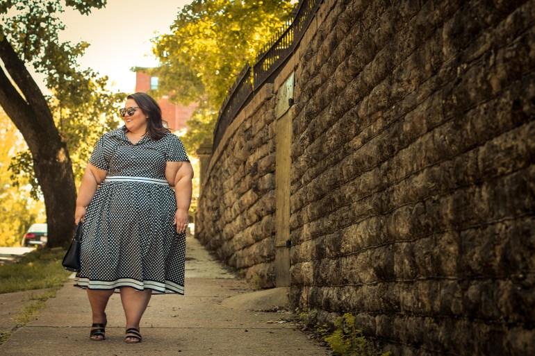 Miranda Schultz of The Plus Life Blog Wears a Custom Black & White Polka Dot Dress From Eshakti overlooking Downtown Cincinnati