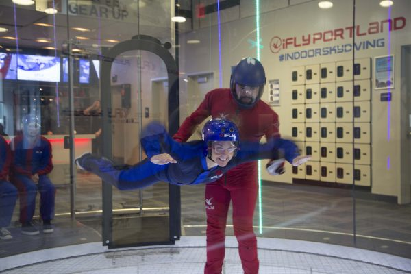 PMG team members learning how to indoor skydive
