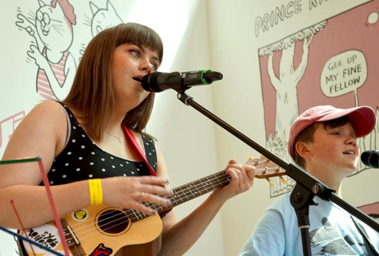 Young woman plays ukelele at The Point in Doncaster