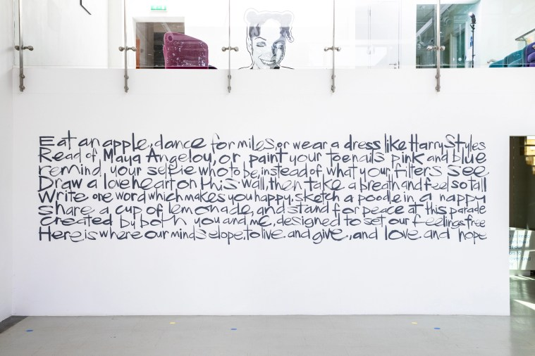Large-scale mural of a poem on a white wall in the Gallery at The Point in Doncaster