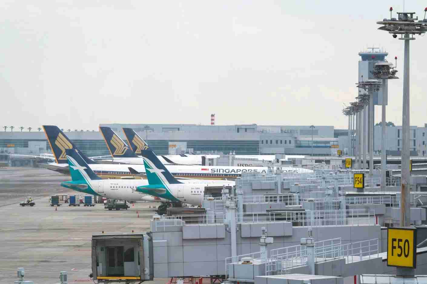 Singapore Airlines Ltd. and SilkAir Singapore Pte aircraft stand on the tarmac at Changi Airport in Singapore, on Thursday, Dec. 13, 2018. Singapore
