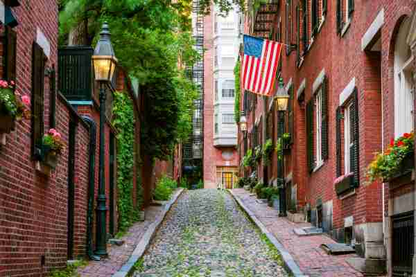 Red Brick houses along Acorn Street, Beacon Hill in Boston. (Photo by joe daniel price/Getty Images)