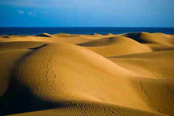 Sand dunes of Maspalomas in Gran Canaria. (Photo by © Allard Schager / Getty Images)