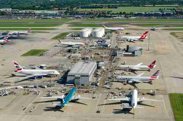 LONDON, UK - JUNE 3, 2017: Commercial airliners parked near the northern fuel supplies at London's busy Heathrow Airport on a sunny summer morning. Planes using the facility include British Airways, Americal Airlines, Cathay Pacific and Qantas.